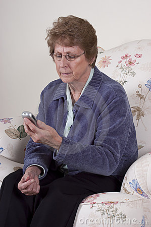 Mature Senior Woman Cell Phone Texting Concern