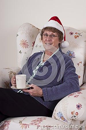 Mature Senior Woman Christmas Entertain Santa Hat