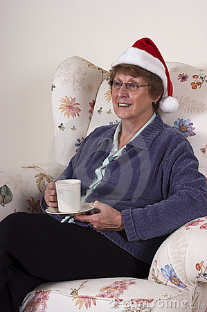 Mature Senior Woman Christmas Entertain Santa Hat