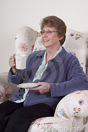 Mature Senior Woman Entertaining Drinking Coffee