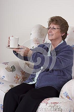 Mature Senior Woman Entertaining Drinking Coffee