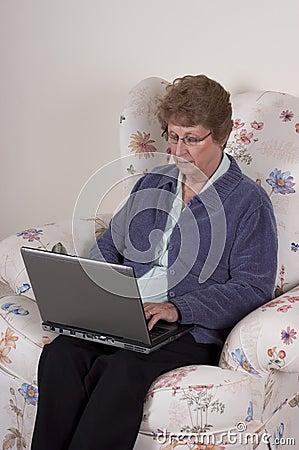 Mature Senior Woman Laptop Computer, Serious Look