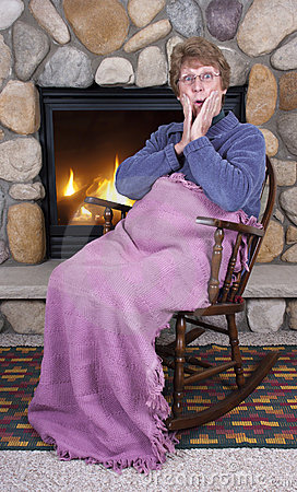 Mature Senior Woman Rocking Chair Fireplace Gossip