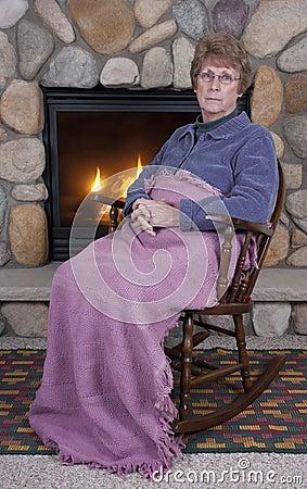 Mature Senior Woman Sad Face Rocking Chair, Fire