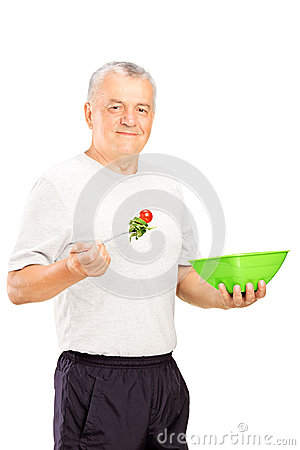 Mature sports man eating a healthy food