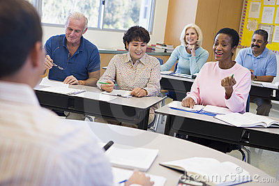 Mature students and their teacher in a classroom