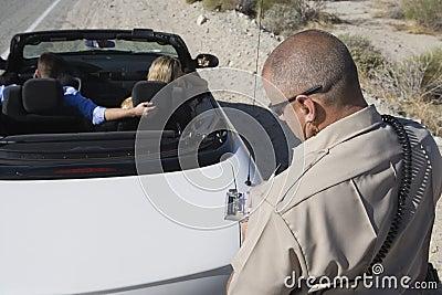 Mature Traffic Cop Writing Ticket