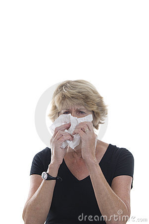 Mature woman with allergies or bad cold