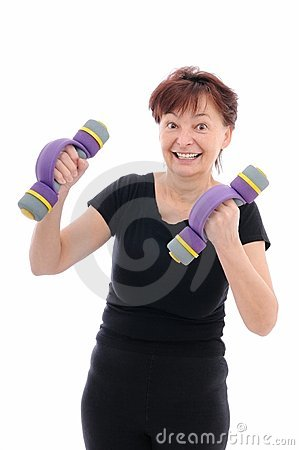 Mature woman with barbells