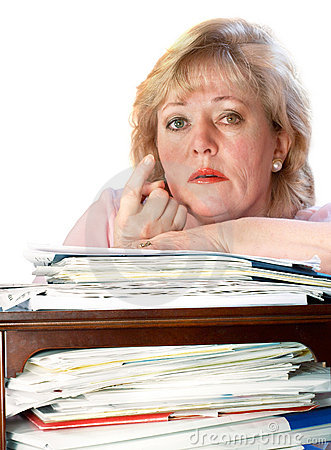 Mature woman beckoning from paper pile