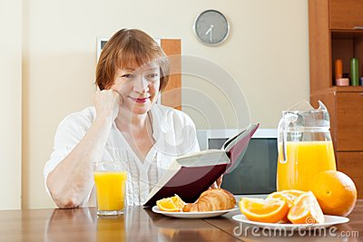 Mature woman  during breakfast