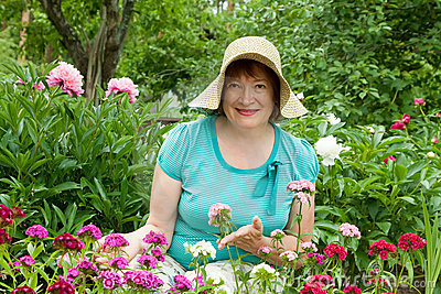 Mature woman in carnation plant