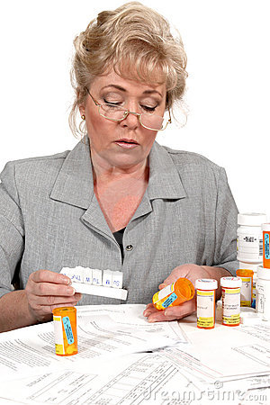 Mature woman checking prescription