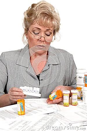 Mature woman checking prescription