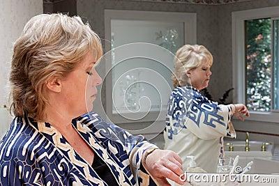 Mature woman checks watch