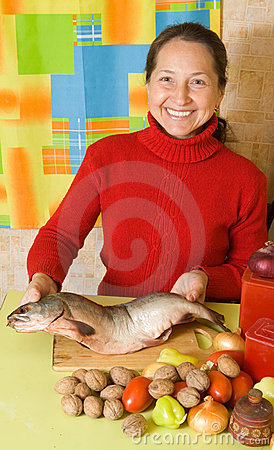 Mature woman is cooking red fish stock image image 16463611 for How to cook red fish