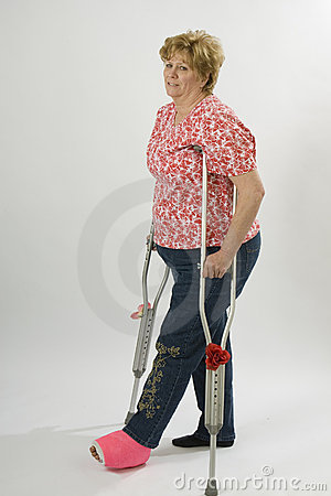 Mature woman on crutches