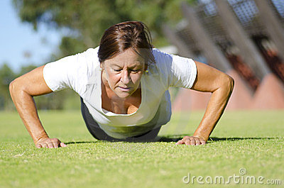 Mature woman doing push up exercise I