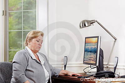 Mature woman dozing at the desk