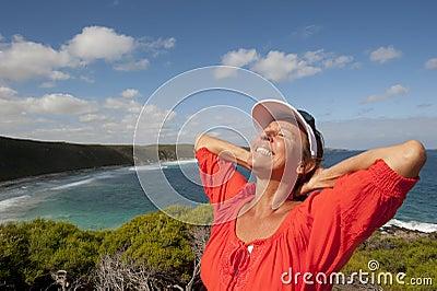 Mature Woman feeling Happy at Seaside