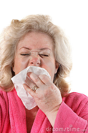 Mature woman with flu sneezing