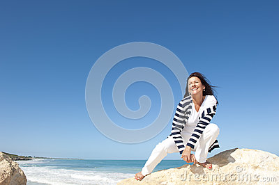 Mature woman fun ocean background