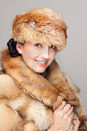 Mature woman in fur hat portrait