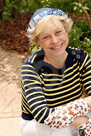 Mature woman with gardening gloves