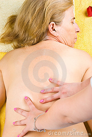 Mature woman getting back massage