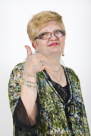 Mature woman giving thumbs up