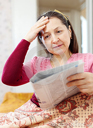 Mature woman having grief  after readed news