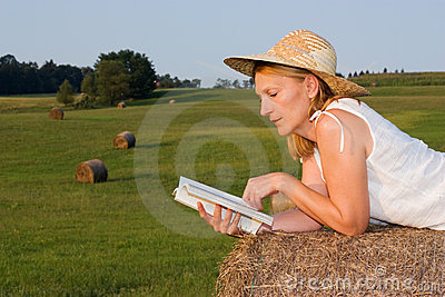 Mature Woman on a haystack