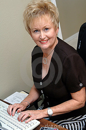 Mature woman in home office