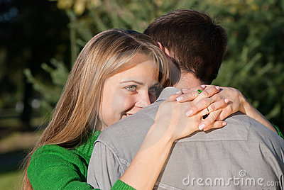 Mature woman hugging her husband with love