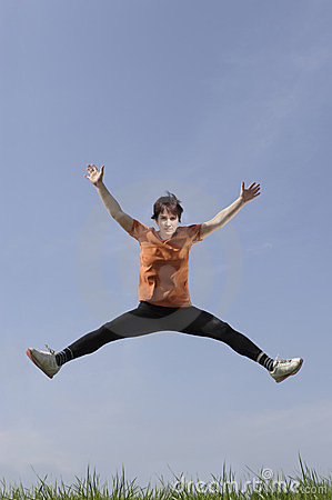 Mature woman jumping in the air