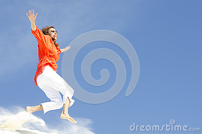 Mature woman jumping with joy