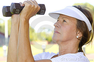 Mature woman lifting weights I