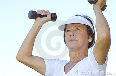 Mature woman lifting weights II