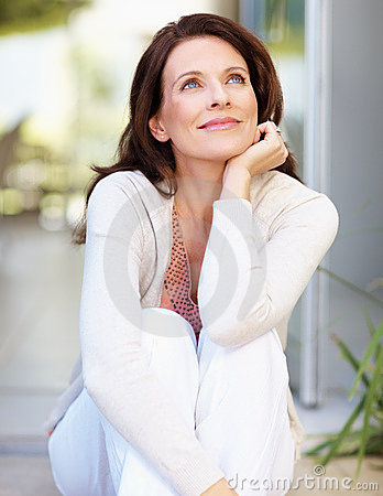 Mature woman looking away day dreaming