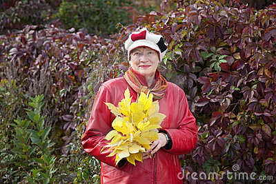 Mature woman with maple posy