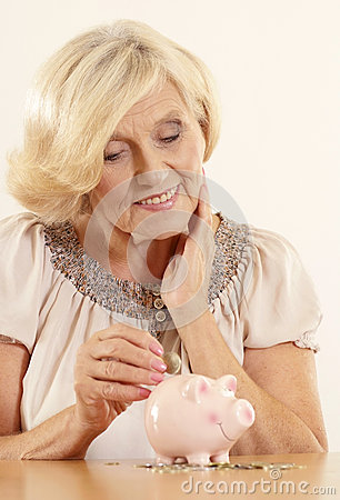 Mature woman with moneybox