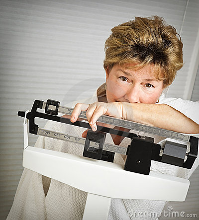 Free Mature Woman On Weight Scale Stock Photos - 9150013