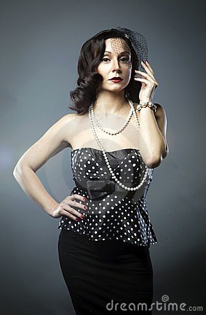 Mature woman in pearl necklace and a black veil