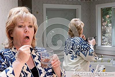 Mature woman pill on tongue