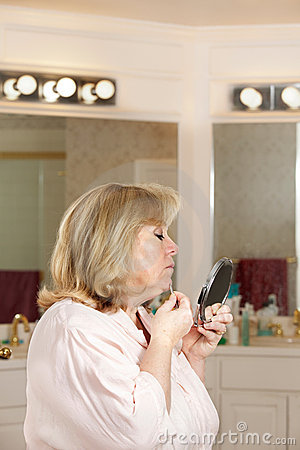 Mature woman plucking hairs