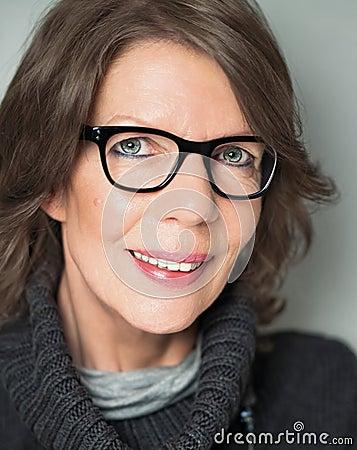 Mature woman portrait with black-rimmed glasses