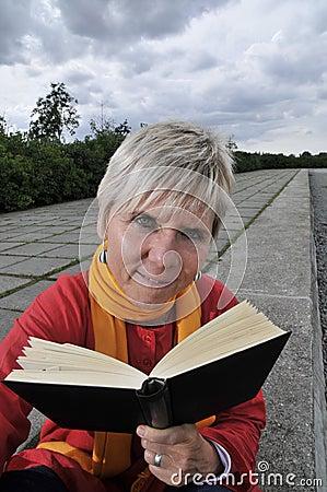 Mature woman reading book