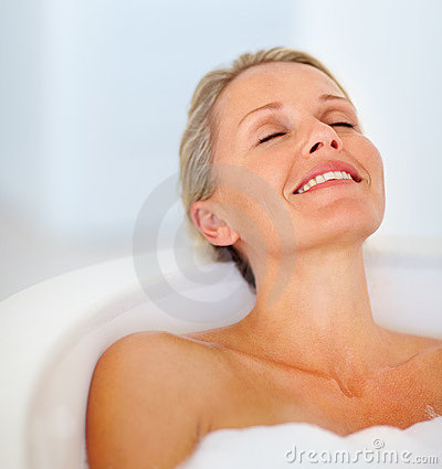 Mature woman relaxing in her bathtub
