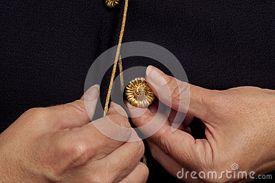 A Mature Woman's Hands Trying to Button a Top