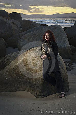 Mature woman at seaside rocks
